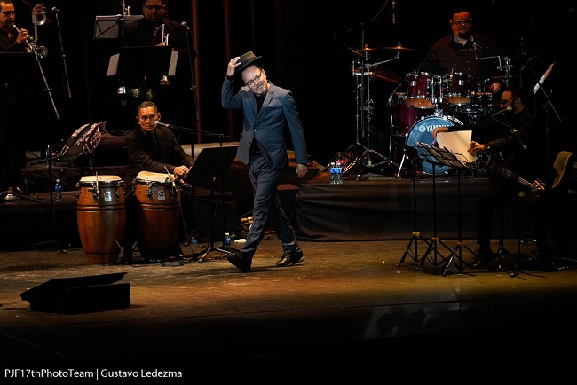 Rubén Blades with blue hat on stage