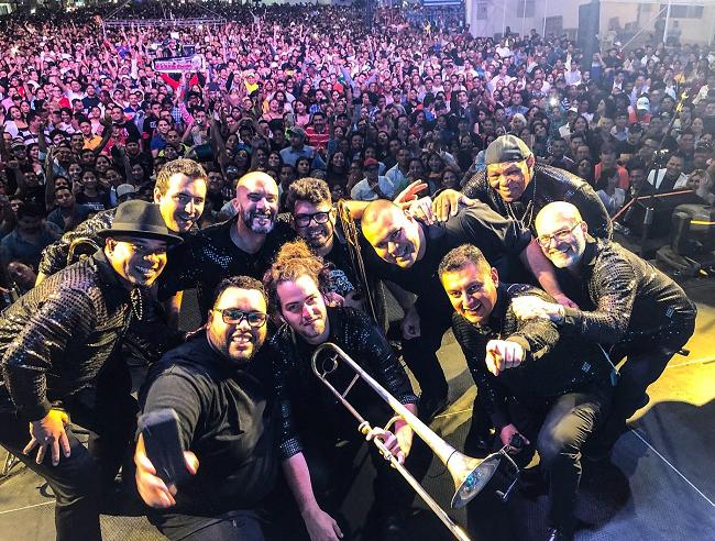 The members of Tromboranga taking a selfie on stage