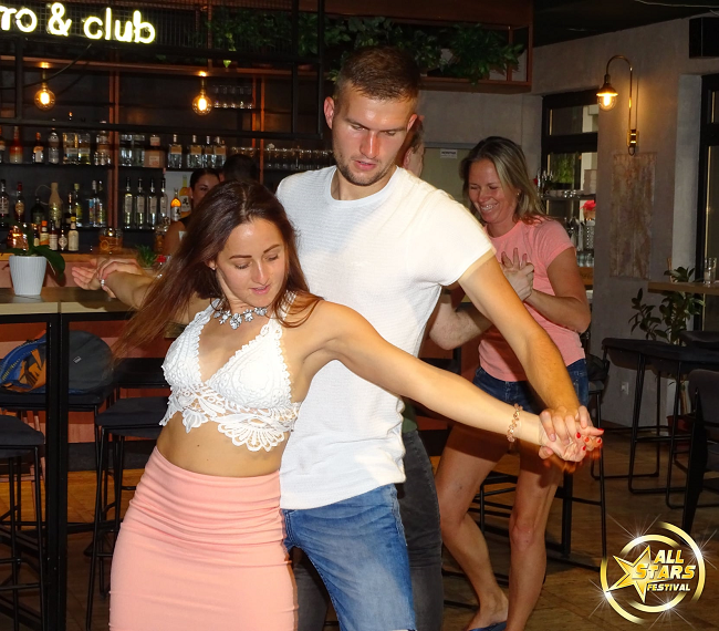 Couple dancing dressed in white upper body
